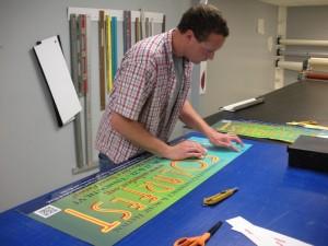 Adam produces the Solarfest bus signs